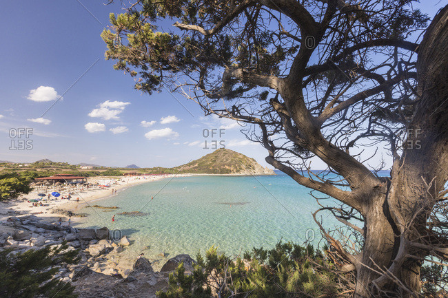 Sardinia, Italy - September 13, 2016: The mediterranean vegetation frames the bay and the turquoise sea of Cala Monte Turno
