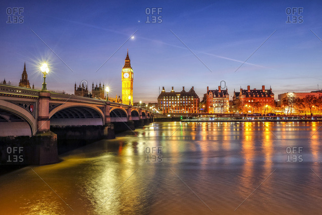 Night view of Palace of Westminster and Big Ben reflecting on Thames river