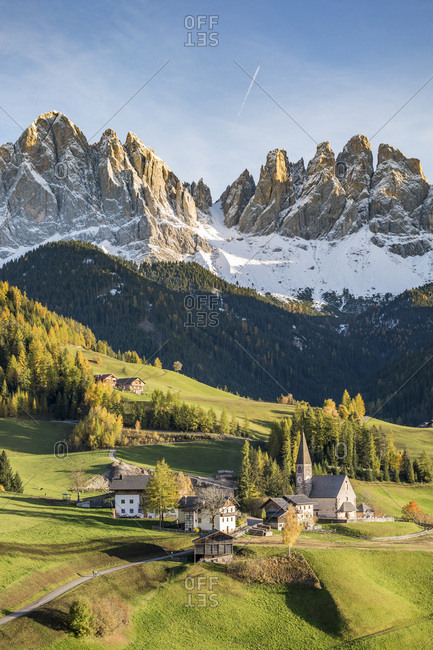 Autumnal landscape with Odle Dolomites peaks on the background