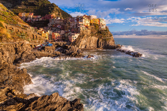 Manarola, one of the five village of Five Lands, is illuminated by winter sunset light