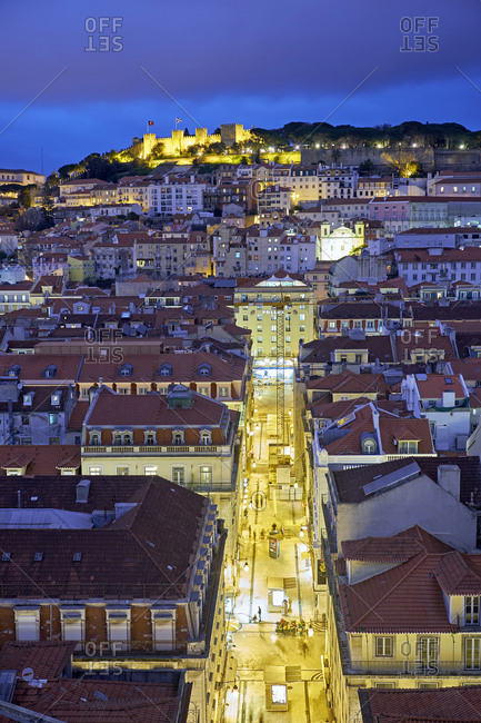 Lisbon, Distrito de Lisboa, Portugal - March 17, 2016: The Rua de Santa Justa and the castle in background at dusk