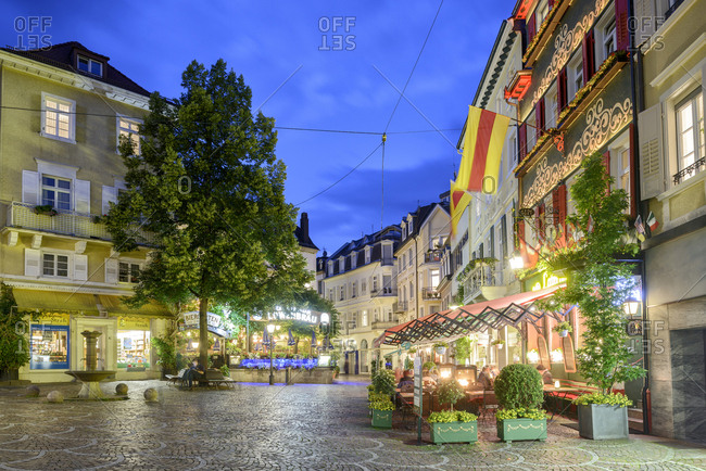 Baden Baden, Germany - January 30, 2016: Restaurants along the Gernsbacher Strasse at dusk