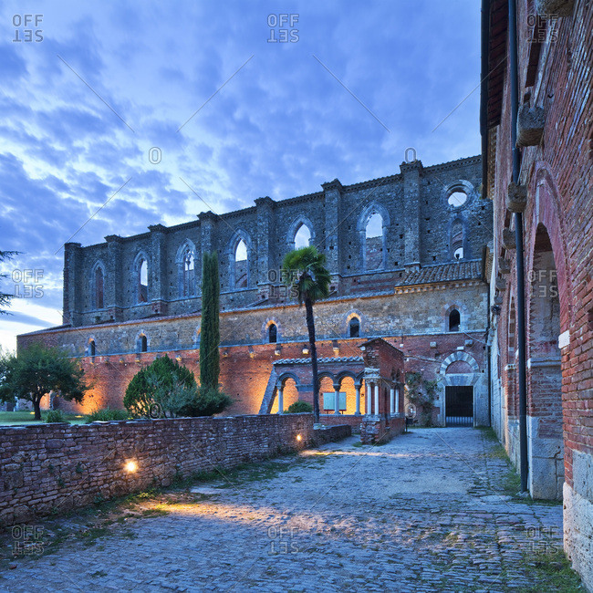 San Galgano Abbey illuminated at dusk