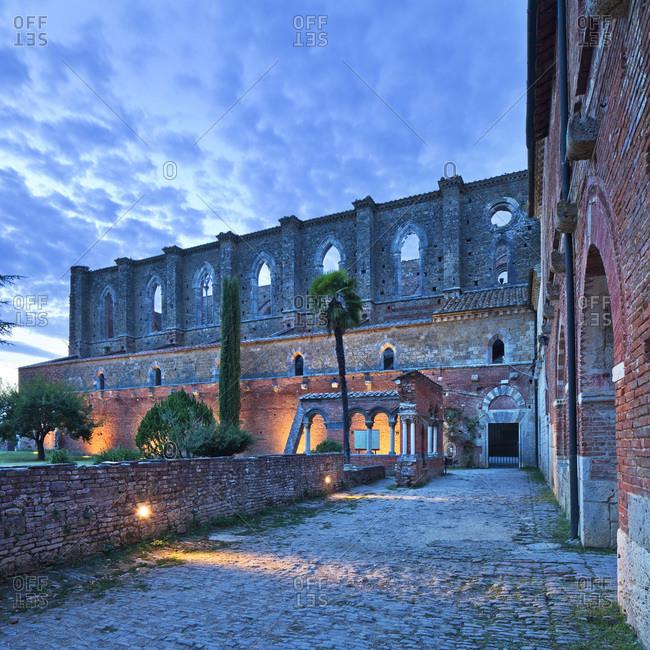 San Galgano Abbey illuminated at dusk
