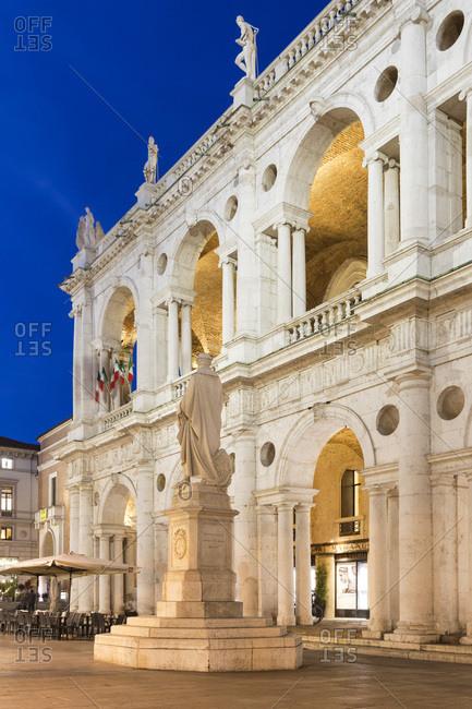 Veneto, Italy - November 13, 2016: Piazza dei Signori, Palladian Basilica, Andrea Palladio statue with Palladian Basilica