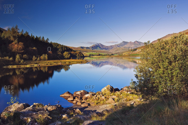 A classic view of the Snowdon mountain range from Capel Curig village, near Betws-y-Coed, with Lynnau (Small Lake) Mymbyr in the foreground