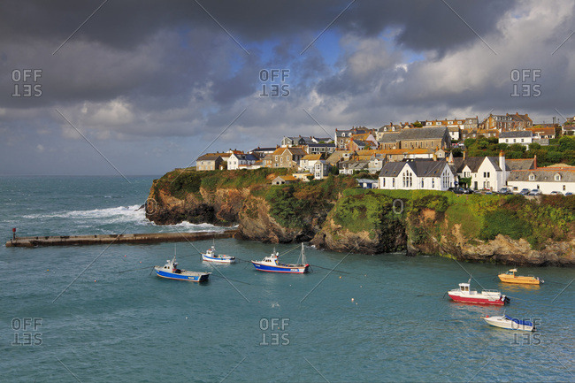 Cornwall, UK - October 15, 2016: The small inlet and fishing harbor of the picturesque seaside village