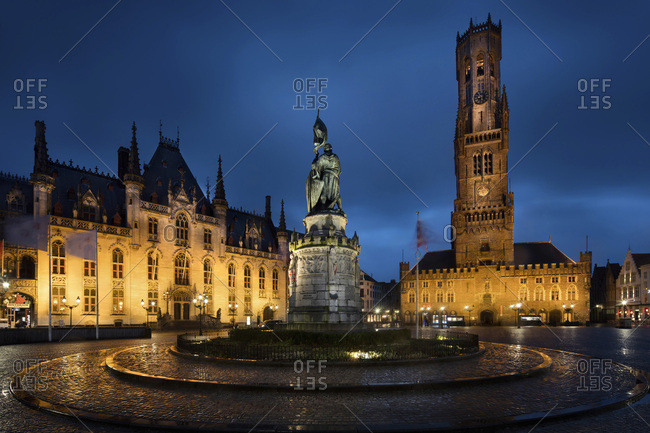 Bruges, Flanders, Belgium - December 8, 2016: Market square with Provinciaal Hof and belfry