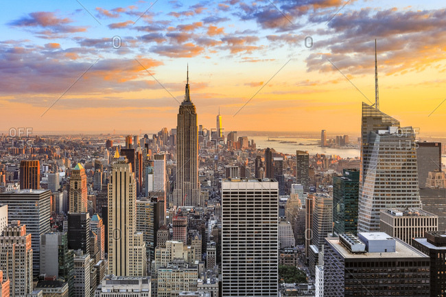 New York City, USA - July 31, 2016: Cityscape with the Empire State Building and the Freedom Tower as seen from Top of the Rock Observation Deck at the Rockefeller Center at sunset