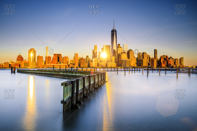 New York City, USA - July 31, 2016: Lower Manhattan skyline with One World Trade Center and Freedom Tower from New Jersey, at sunset from new port