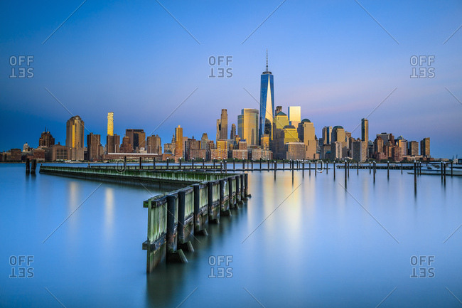Lower Manhattan skyline with One World Trade Center and Freedom Tower from New Jersey, at sunset from new port