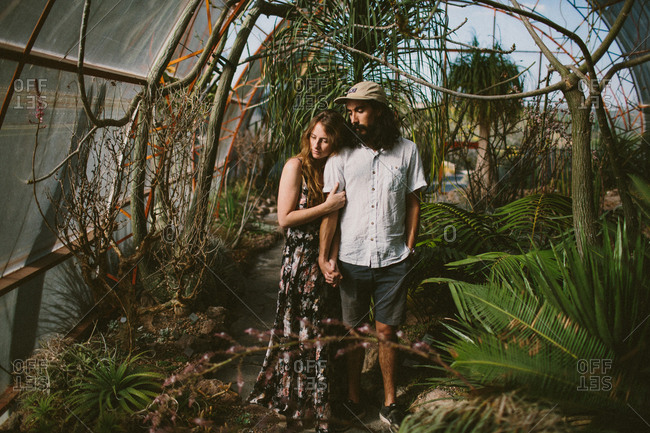 Couple in a greenhouse with desert plants