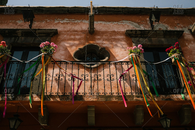 Ribbons hanging from a balcony