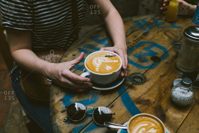Woman holding a latte