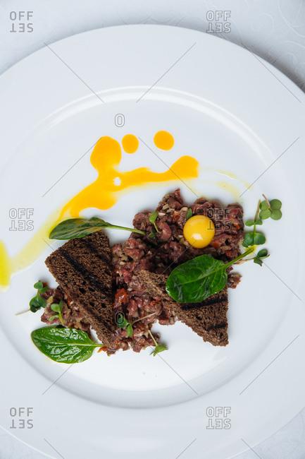 Raw tartar dish with egg