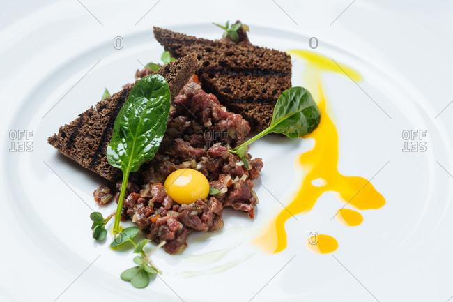 A raw tartar dish with egg