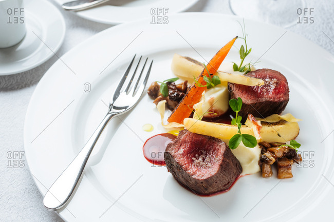 Beef steak and veggies on a plate