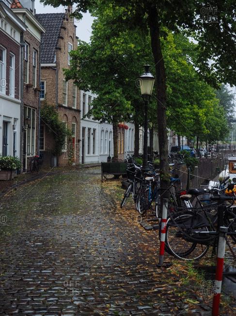 Amsterdam, Netherlands - July 19, 2015: Street with cobblestone sidewalks