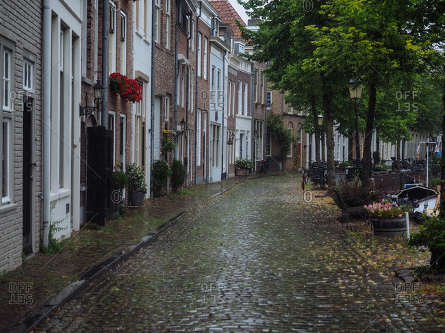 Amsterdam, Netherlands - July 19, 2015: A street with cobblestone sidewalks