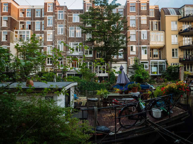 Amsterdam, Netherlands - July 19, 2015: Terrace of a house boat in canal