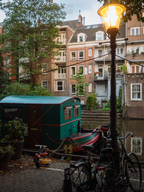 Amsterdam, Netherlands - July 19, 2015: Streetlamp near a canal