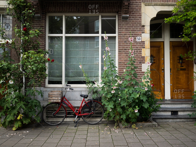 Amsterdam, Netherlands - July 20, 2015: A bike outside a home