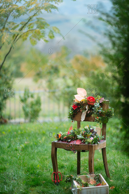 Floral wreaths set on a chair