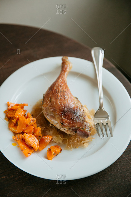 Chicken drumstick with carrots
