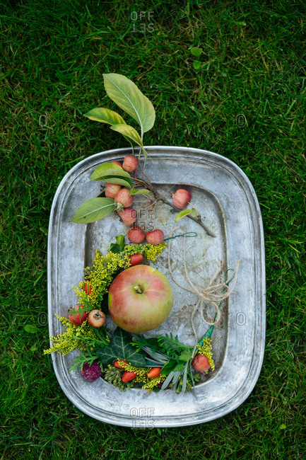 Apples and flowers on tray