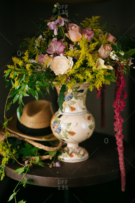 Hat by a floral vase