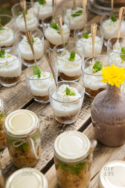 Cream desserts on outdoor table