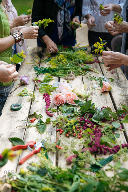 Women making flower arrangements