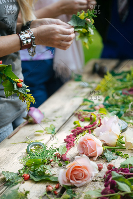People making flower arrangements