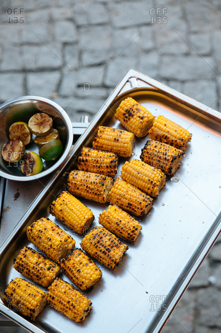 Cooked corn cobs on tray