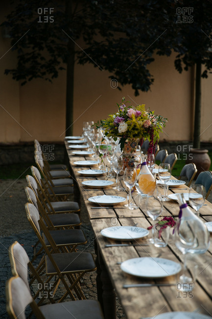 Wood tables set for outdoor meal