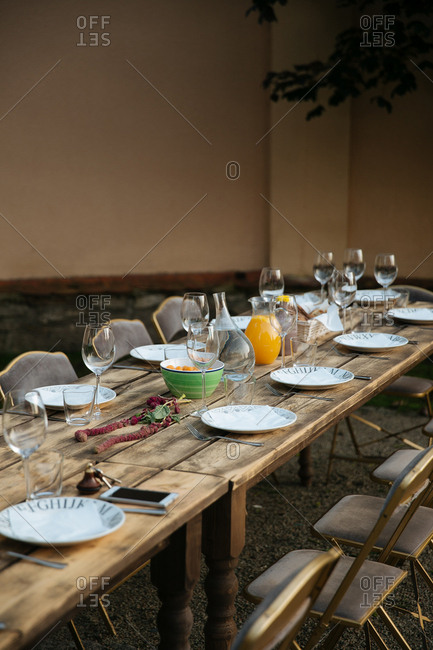 Wood tables arranged for outdoor meal