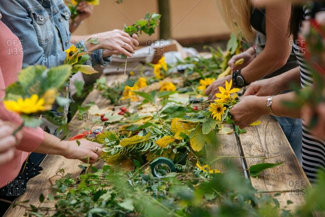 Women arranging flowers outside