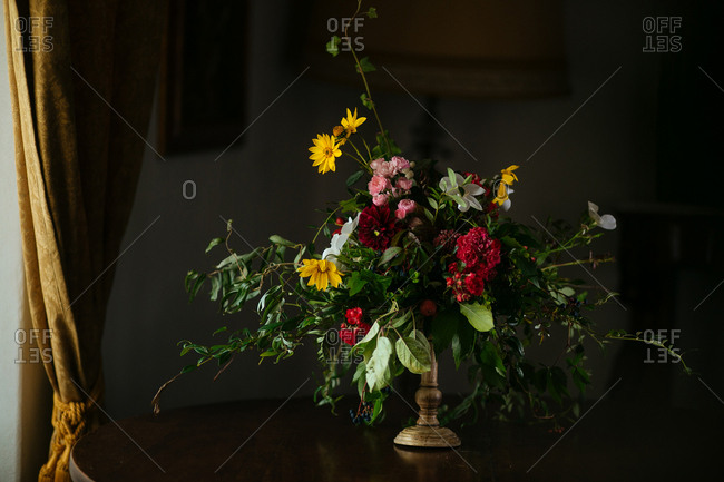 A floral arrangement on indoor table