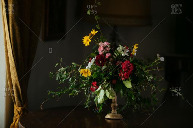 A floral arrangement on indoor table