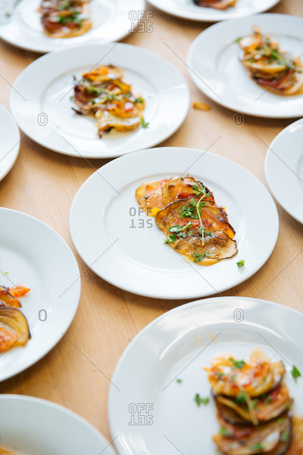 Vegetable appetizers in sauce on plates