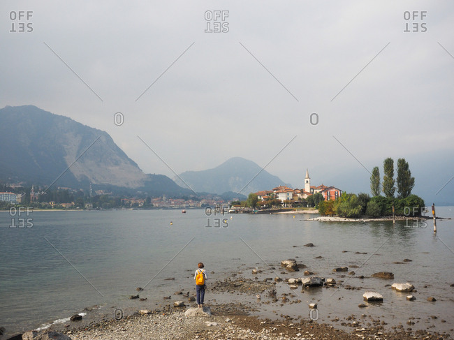 Stresa, Italy - March 3, 2017: Woman on the shore