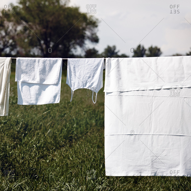 White linen hanging on a clothesline outdoors