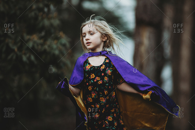 Girl playing in a purple satin cape