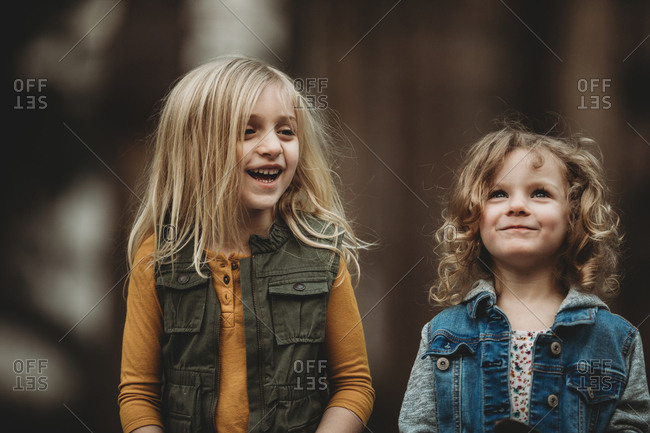 Two young girls laughing together
