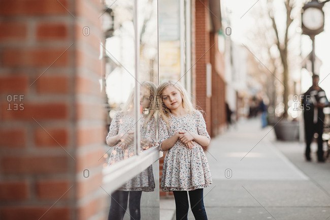 Young girl waiting outside store