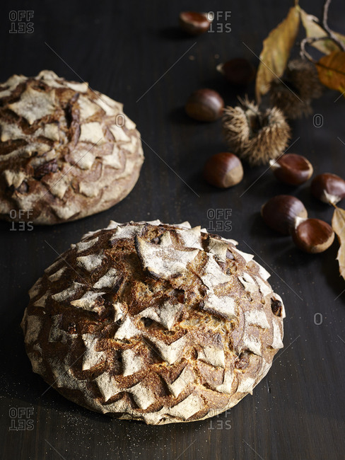 Round loaves of chestnut bread and whole chestnuts