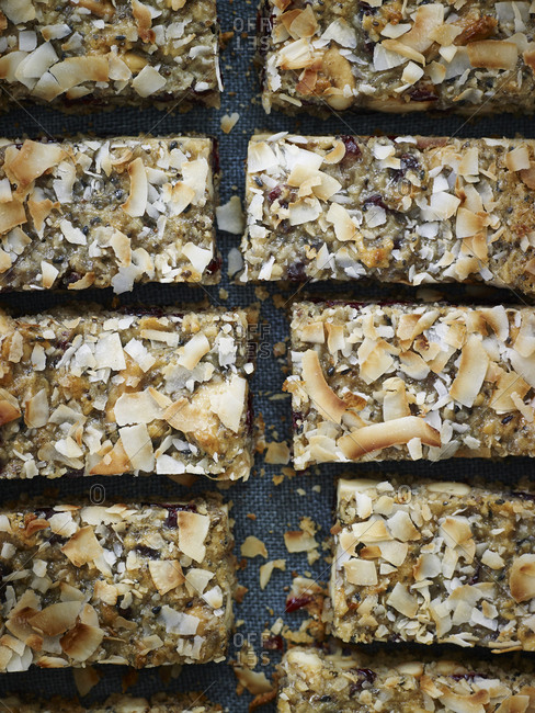 Snack bars with toasted shaved coconut on a cloth