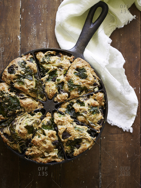 Cast iron pan with kale and mushroom scones