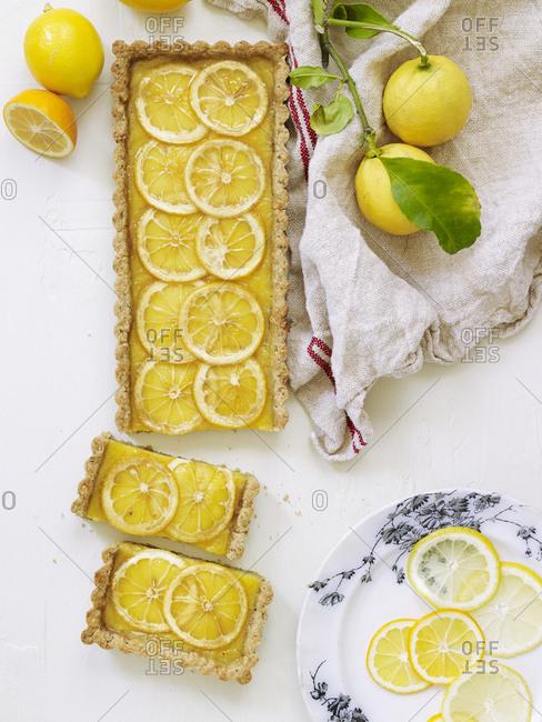 Overhead view of sliced lemon tart