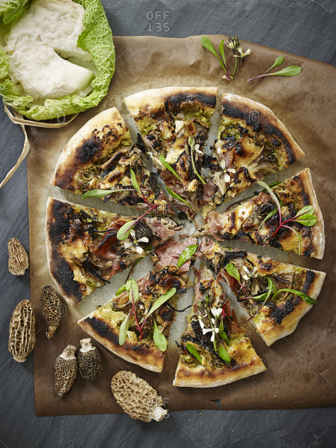 Sliced pizza with morel mushrooms